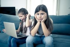 Young little girl using laptop ignoring her angry sad lonely old stock photography