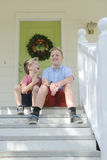 Sibling Brothers Sitting on the Front Porch Royalty Free Stock Photography