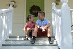 Sibling Brothers Sitting on the Front Porch Stock Photos