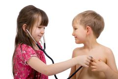 Sibling Checkup Stock Photo
