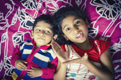 Sibling children playing having fun on bed Royalty Free Stock Photo