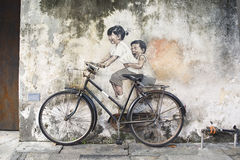 Sibling Cyclist Street Art Mural in Georgetown, Penang, Malaysia Stock Photo