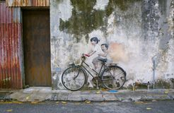 Sibling Cyclist Street Art Mural in Georgetown, Penang, Malaysia. Little Children on a Bicycle or Sibling Cyclist Street Art Mural in Armenian Street, George Stock Photos