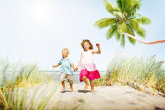 Sibling Happiness Summer Beach Vacations Concept.  Royalty Free Stock Image