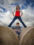 Sibling hay bales fun. Royalty Free Stock Images