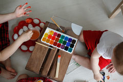 Free Sibling Kids Paint Eggs , Concept Easter Stock Photography - 84432142