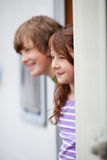 Sibling Looking Away While At Doorway Of RV Royalty Free Stock Photos