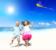 Sibling Playing Together Beach Kite Concept Royalty Free Stock Photo