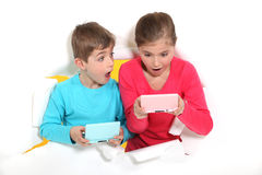 Sibling playing video games Royalty Free Stock Photo