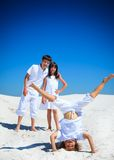 Sibling playing on white beach Stock Photography