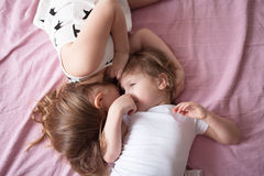 Sibling relationships, children's secrets, hug, close up, domest Stock Photography