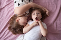 Sibling relationships, children's secrets, hug, close up, domest Stock Photo