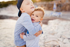 Sibling sentiment. Portrait of two little boys brothers hugging each other outside Royalty Free Stock Photography