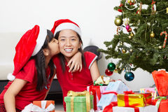 Sibling showing love in Christmas season Stock Photos