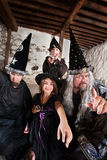 Sibling Wizards and Father. Sister and brother wizards casting spells with their father stock photography