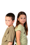Siblings 1. Young brother and sister standing back to back Stock Images