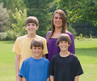 Siblings. Four Brothers and  Sisters Smiling Royalty Free Stock Photos