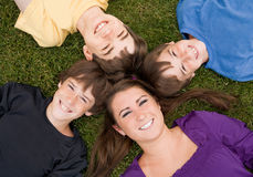 Siblings. Four Brothers and  Sisters Smiling Royalty Free Stock Image