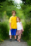 Siblings. Brother and sister outdoors on a summer day Royalty Free Stock Image