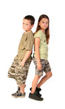 Siblings 2. Children wearing camouflage standing back to back Royalty Free Stock Image