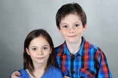 Siblings. Harmonious siblings posing for a photo Stock Photo