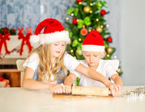 Siblings baking Christmas cookies Stock Image