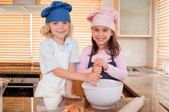 Siblings baking together Royalty Free Stock Image