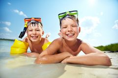 Siblings on beach Royalty Free Stock Photography