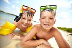 Siblings on beach Stock Photos