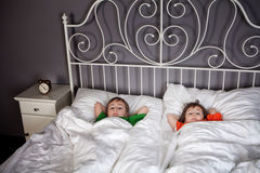 Siblings in bed Stock Photography