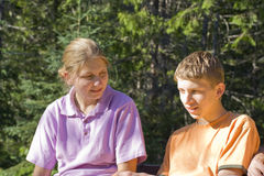 Siblings on a bench Royalty Free Stock Photo