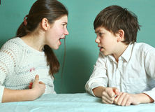 Siblings boy and girl arguin close up photo Stock Photos