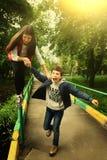 Siblings boy girl fun teenager. Climb naughty outdoor active Royalty Free Stock Photo