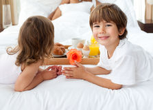 Siblings bringing breakfast to their parents Stock Image