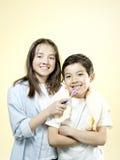 SIblings brushing teeth. Stock Image