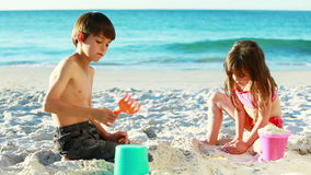 Siblings building sand castles Royalty Free Stock Photography