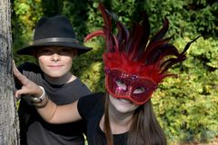Siblings in carnival outfit royalty free stock images