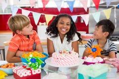 Siblings celebrating birthday in kitchen Stock Photo