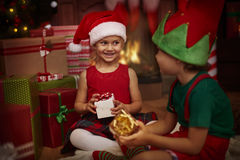 Siblings during Christmas Stock Images