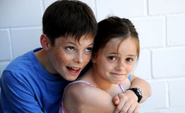 Siblings in cohesion. Happy siblings hugging each other Royalty Free Stock Photos