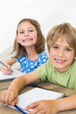 Siblings coloring at table Stock Images