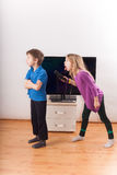 Siblings conflict over the remote control Stock Image