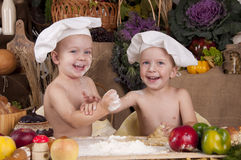 Siblings Cooking In Chef S Hats Stock Photos