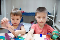 Siblings crafting, children development concept Stock Photo