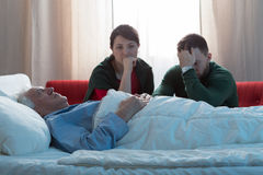 Siblings and dead father. Adult siblings crying after their dead father Royalty Free Stock Photography