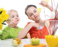 Siblings decorates Easter eggs Stock Photo