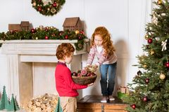 Siblings decorating christmas tree Royalty Free Stock Photography