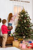 Siblings decorating christmas tree Royalty Free Stock Images