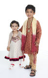 Siblings Display Traditional Indian Costumes Royalty Free Stock Photos