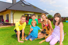 Siblings with dog. Teens with dog by their home Royalty Free Stock Photography